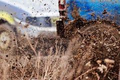 Wreck scrap cars dirt race. Selective focus on splashing mud Royalty Free Stock Image