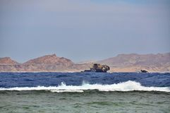 Wreck ship opposite the island of Tiran in the Red Sea. The ship, castaway in the Red Sea at coast of the island the Tyrant in 1982 Royalty Free Stock Photography