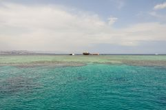Wreck ship opposite the island of Tiran in the Red Sea Royalty Free Stock Image