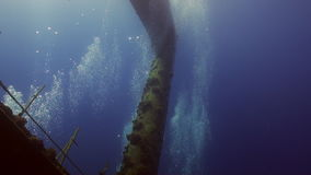 Wreck ship underwater on coral reef Abu Nuhas on blue background in Red sea. Swimming in world of colorful beautiful wildlife of fish and algae. Inhabitants in stock footage