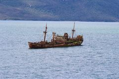 Wreck of a ship in a Chilean fjord stock photos