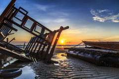 Wreck at Tanjung aru beach, Labuan. Malaysia 02. Wrick at Tanjung Aru beach Labuan Malaysia. with beautiful sunrise Royalty Free Stock Photo