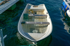 Wreck of a wooden boat grounded in the harbor royalty free stock photography