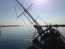 A wreck of a yacht in a harbour. A sunken boat in a harbour Royalty Free Stock Images