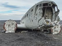 Wreckage of crashed airplane on the coast of iceland. Black sand beach Royalty Free Stock Images