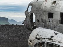 Wreckage of crashed airplane on the coast of iceland. Black sand beach Royalty Free Stock Photo