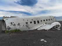Wreckage of crashed airplane on the coast of iceland. Black sand beach Stock Images