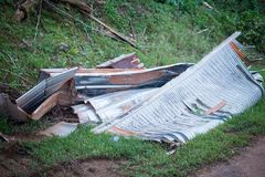The wreckage of Hurricane Maria. The remains of a roof destroyed by Hurricane Maria on the side of the road in Lares, Puerto Rico Stock Image
