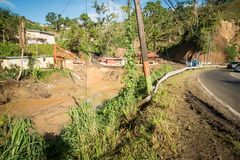 The wreckage of Hurricane Maria. A view of a sinkhole made by Hurricane Maria in Naranjita, Puerto Rico Royalty Free Stock Photos