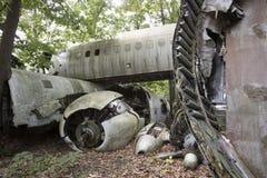 Wreckage of plane crash. Wreckage of crashed plane in wooded junkyard Royalty Free Stock Photos