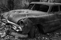 Wreckage of a Car. Wreckage of a wintage car lying in a dumping ground Stock Images