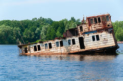 Wrecked abandoned ship on a river Royalty Free Stock Photos