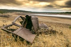 Wrecked antique car on the Lake Shore 3 stock photo