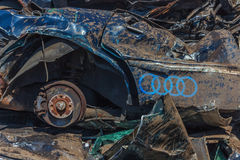 Wrecked Audi. Smashed  and abandoned automobile in the landfill Stock Photo