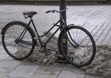 Old bike. Wrecked bike pinned to the lamp in the center of the city krakow Stock Photography