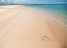 Wrecked boat on isolated and pristine beach in the North Kimberley. I wonder what or where this lonely deserted boat came from and what stories it could tell royalty free stock image
