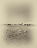 Wrecked boat at receding shore Royalty Free Stock Photo