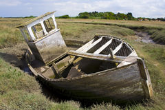 Wrecked boat stranded in mud Royalty Free Stock Photo