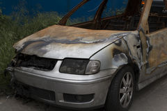 Wrecked and burning car close up Royalty Free Stock Photo