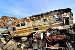 Wrecked bus in a junkyard Stock Image