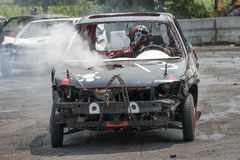 Wrecked car in action. Napierville demolition derby, July 12, 2015, picture of wrecked car in action during the demolition derby royalty free stock photo