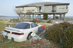 Wrecked car and debris in front of house Stock Images