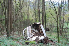 Wrecked car in the forest in Tuscany area royalty free stock images
