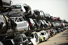 Wrecked car junkyard. Wrecked vehicles are seen in a car junkyard stock photos