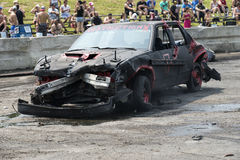 Wrecked car. Napierville demolition derby, July 12, 2015, picture of damaged car at the end of demolition derby stock image