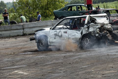 Demolition derby. Napierville demolition derby, July 12, 2015, picture of white wrecked car in action during the demolition derby stock images