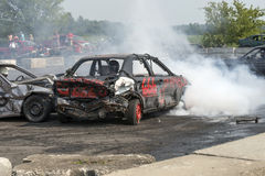 Demolition derby. Napierville demolition derby, July 12, 2015, picture of damaged car making a smoke show during the demolition derby stock photography