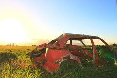 Wrecked car. With sunset background royalty free stock image