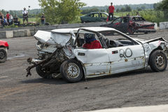 Demolition derby. Napierville demolition derby, July 12, 2015, picture of white wrecked car winner at the end of demolition derby royalty free stock photos