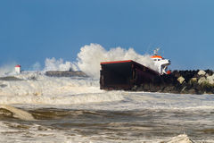 Wrecked Cargo. The spanish cargo Luno broken into two parts stuck in front of a breakwater at the entry of the Anglet port, France Royalty Free Stock Photo