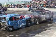 Wrecked cars in action during the demolition derby Stock Photo