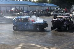 Wrecked cars in action during the demolition derby Stock Photos