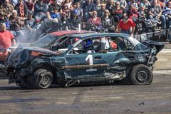 Wrecked cars in action during demolition derby Stock Image