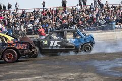 Wrecked cars in action during demolition derby Stock Photos