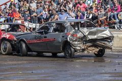 Wrecked cars in action during demolition derby Stock Photo