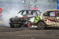 Demolition derby. Napierville demolition derby, July 12, 2015, picture of wrecked car with engine smoking at the demolition derby royalty free stock images