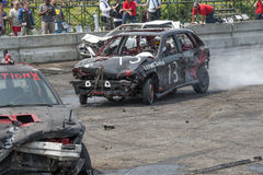Demolition derby. Napierville demolition derby, July 12, 2015, picture of wrecked car in action making a smoke show during the demolition derby stock photos