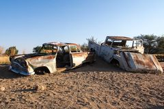 Wrecked cars in the desert surrounding Solitaire in Namibia stock image