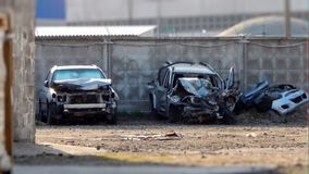 Wrecked cars after road collision Stock Images