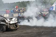 Demolition derby. Napierville demolition derby, July 12, 2015, picture of wrecked car in action making a smoke show during the demolition derby royalty free stock images