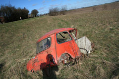 Wrecked motor car in field Royalty Free Stock Image