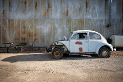 Wrecked old car. Side view of wrecked or scrapped old Volkswagen Beetle car outdoors stock photos