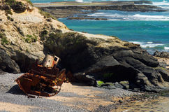 Wrecked old and ruined pusher boat on the beach Royalty Free Stock Photo