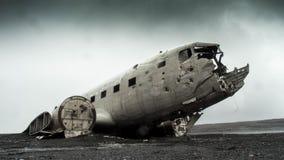 Wrecked plane in field