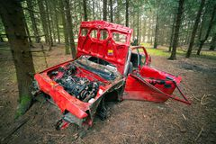 Wrecked Red Car. Red Wrecked car deep in the woods royalty free stock image