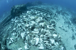 Wrecked remains of the cargo of a shipwreck. Royalty Free Stock Photo
